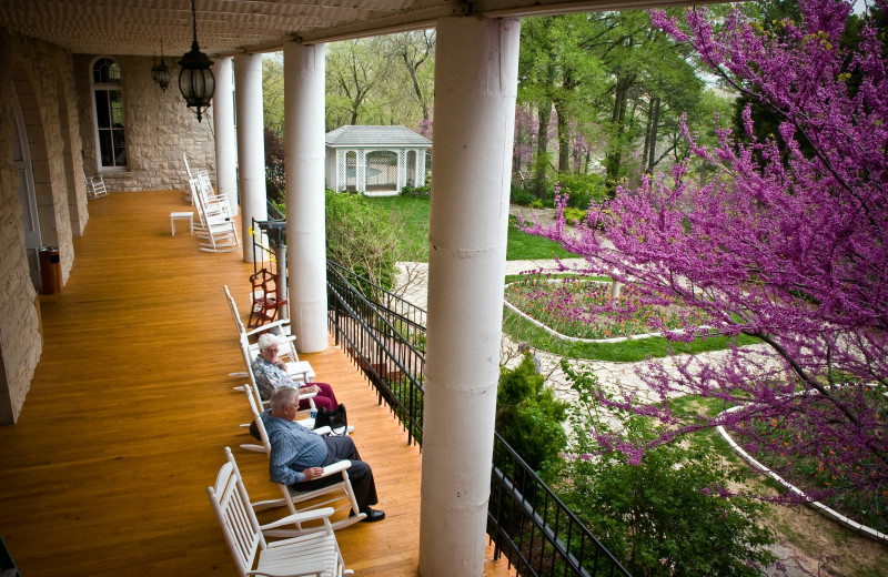 View of the garden from back porch veranda at at The 1886 Crescent Hotel & Spa.