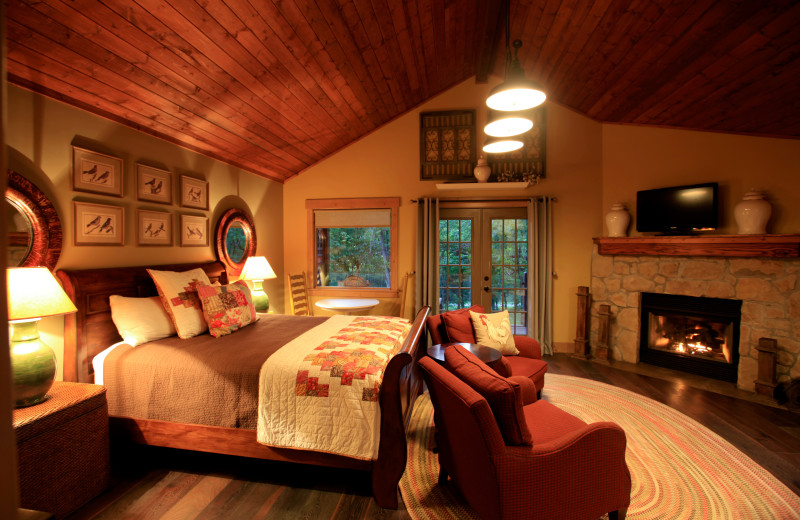 Cabin interior with fireplace at Morrell Ranch.