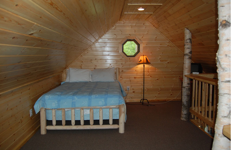 Cottage bedroom at The Elms Waterfront Cottages.