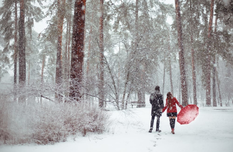 Couple in snow at Superior Shores Resort.