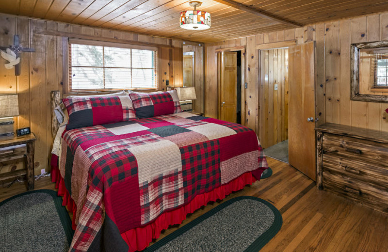 Cabin bedroom at Rocky Mountain Lodge