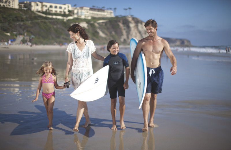 Family on beach at The Ritz-Carlton, Laguna Niguel.
