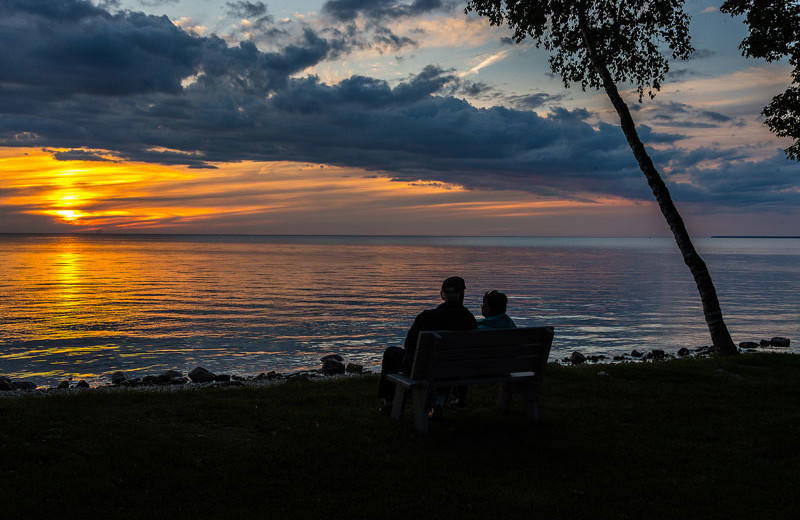 Couple watching the sunset at The Shallows Resort.