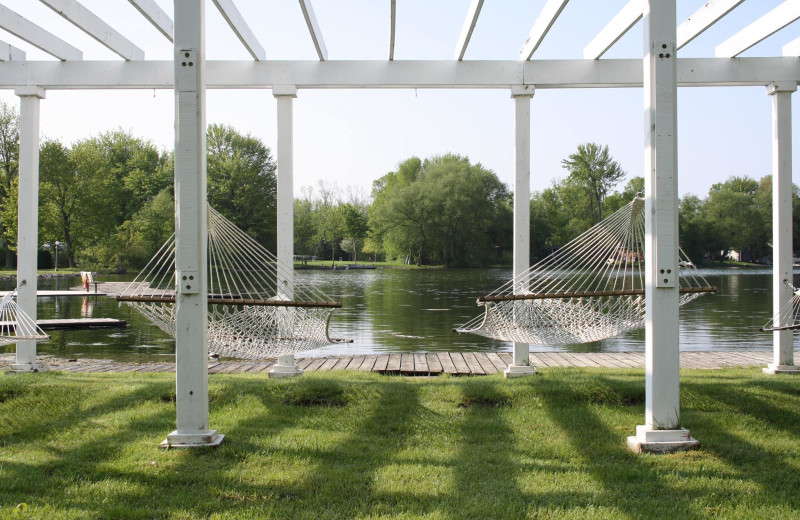 Scenic view of pergola with hammocks overlooking Lake Couchiching.