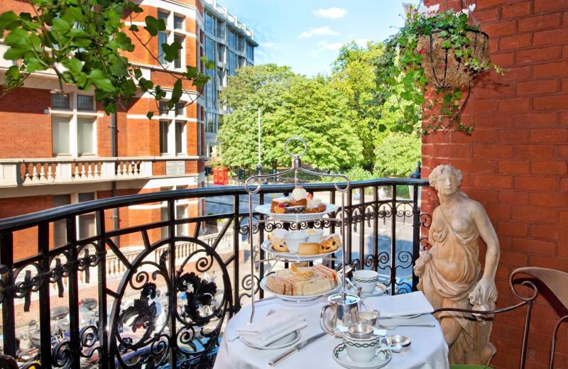 Balcony dining at The Milestone Hotel.