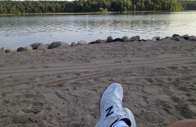 Relaxing on the beach at Kavanaugh's Sylvan Lake Resort.