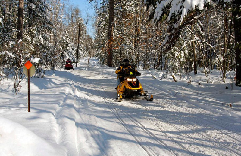 Snowmobiling at Northwoods Vacation Lodgings.