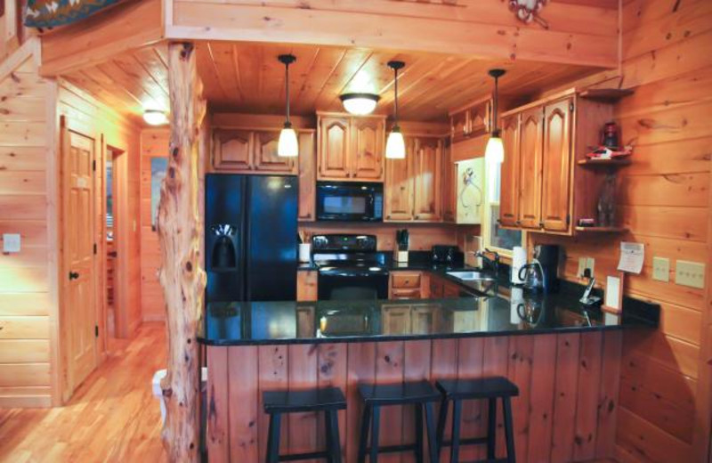Cabin kitchen at Mountain Getaway Cabin Rentals.