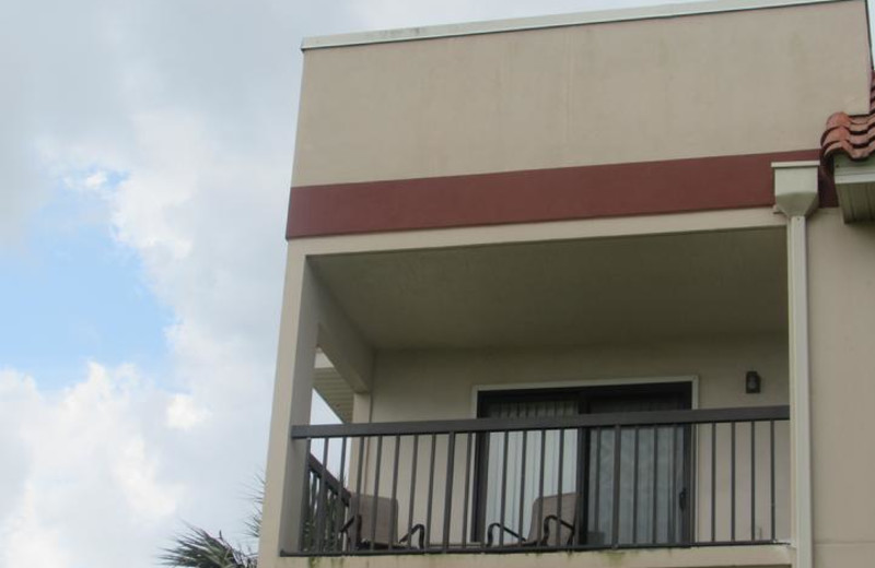 Balcony with sliding doors from living area and master bedroom