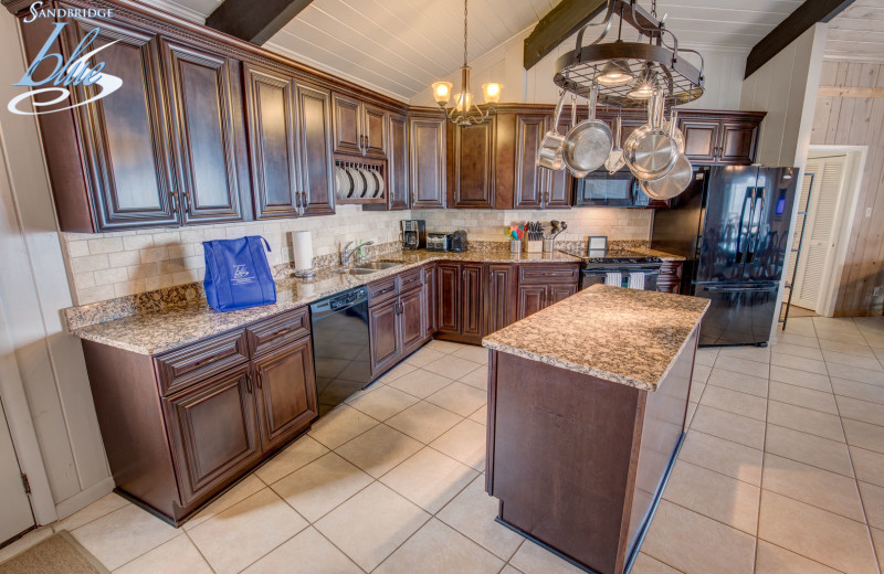 Rental kitchen at Sandbridge Blue Vacation Rentals.