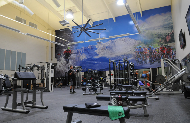 9,000 square foot fitness facility with cardio equipment, free weights, personal trainers, and group fitness classes.