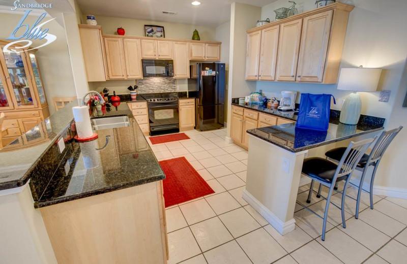 Rental kitchen at Sandbridge Blue Vacation Rentals.