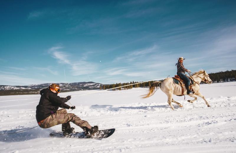 Horseback snowboarding at The Green O.