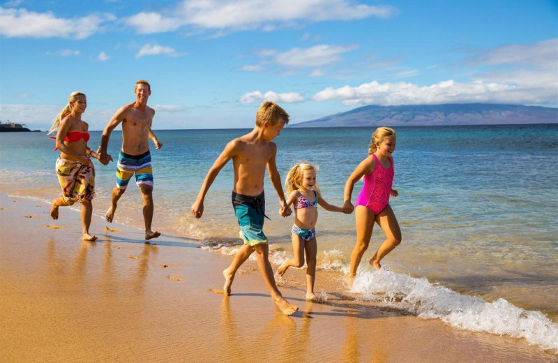 Family on beach at Honua Kai Resort & Spa.