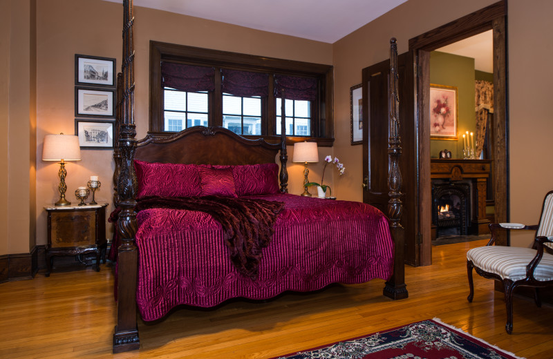 This very spacious two-room suite, with its own private parlor with fireplace, has a magnificently carved four-poster king bed and a large loveseat in the bay windows overlooking the back yard. It is located on the first floor of the inn, making it suitable for people with mobility issues.
