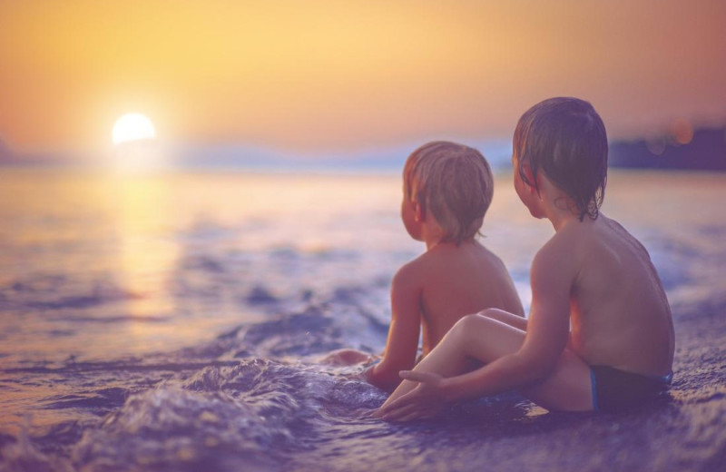 Kids on beach at Cove Inn on Naples Bay.