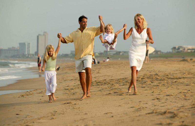 Family on beach at Gold Key Resorts.