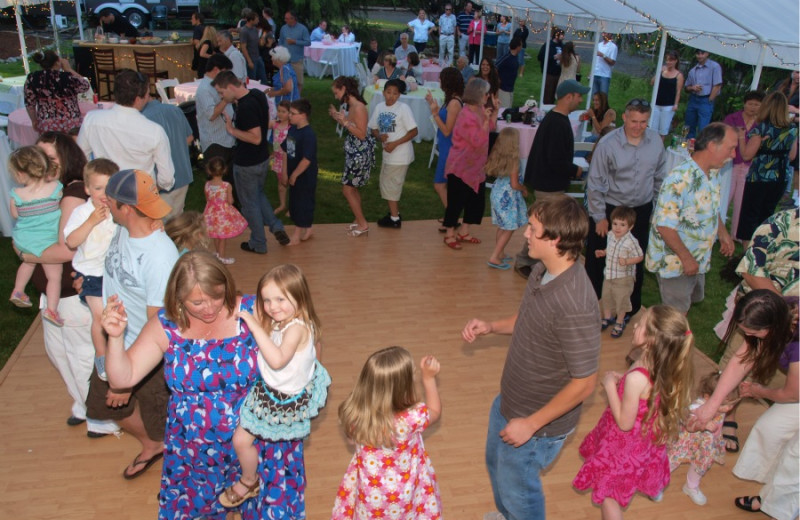 Family dancing on dance floor at Hood Canal Cottages.