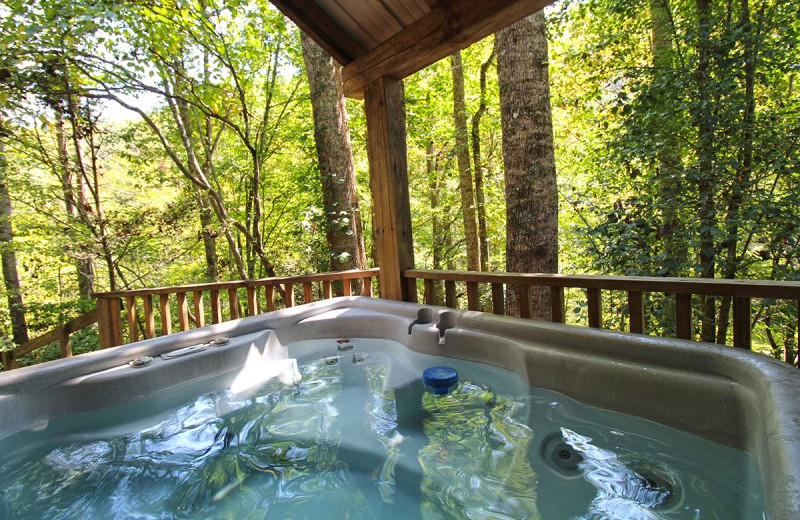 Rental hot tub at Hidden Creek Cabins.