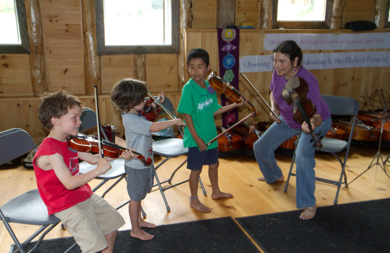 Music lessons are included for all ages during Common Ground Center's family camp programs.