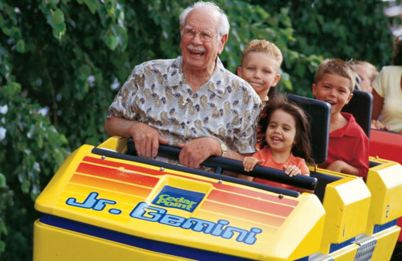 Family riding roller coaster at Cedar Point Resort.