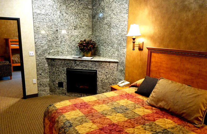 King Bunkbed Suite. This room comes with a King bed and a bunkbed, two bathrooms, two fireplaces, 3 tv's, a living room area, and wetter with fridge and microwave.