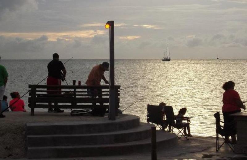 Family fishing at Coral Bay Resort.