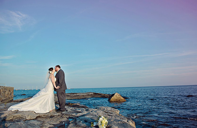 Wedding couple on the beach at Madison Beach Hotel.