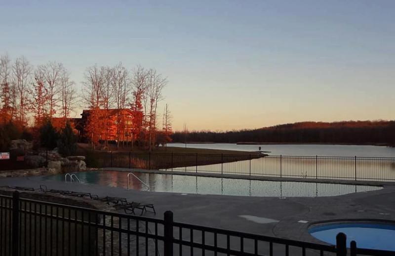Outdoor pool and lake at Highland Rim Retreats.