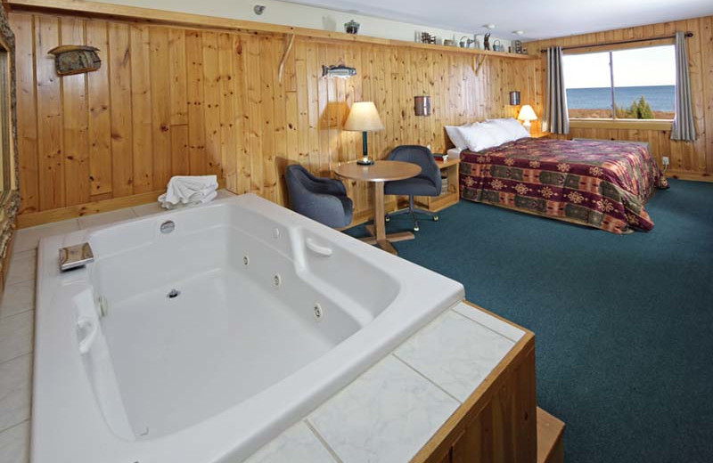 Guest room with jacuzzi at Superior Shores Resort.