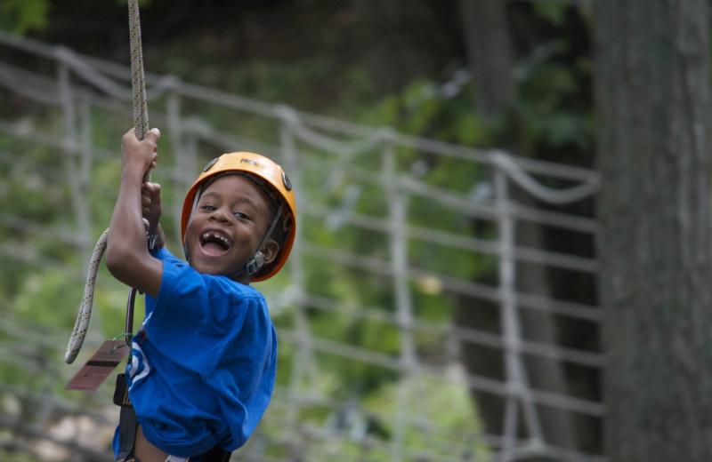 Child on zip line at Massanutten Resort.
