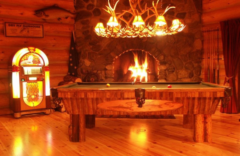 Fireplace and billiards table at Deep Creek Fishing Club.