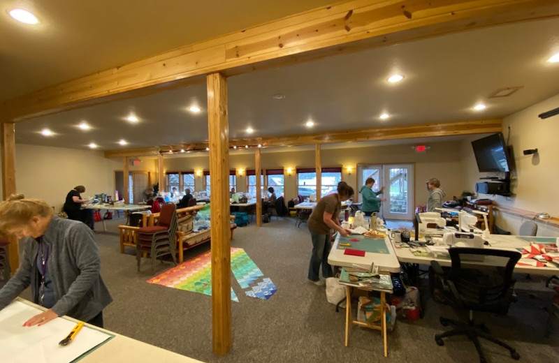 Quilters utilize the Grand Vermilion Chalet's meeting and gathering space.
