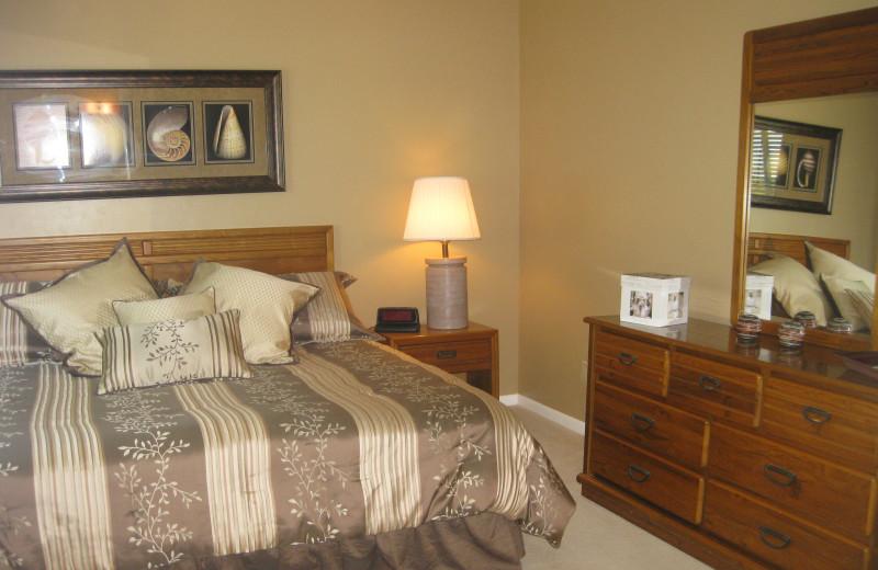 Vacation rental bedroom at Island Breeze Vacation Rentals.
