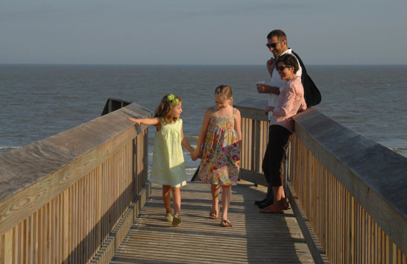 Family on the boardwalk at Hampton Inn & Suites Jekyll Island.