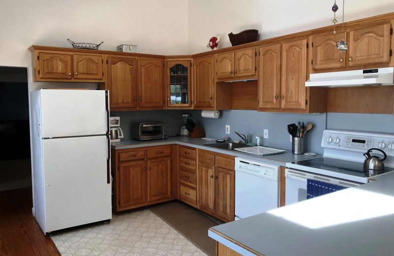 Rental kitchen at At The Lake Vacation Rentals.