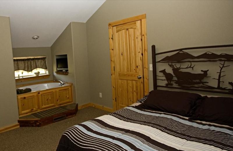 Cabin bedroom at The Cabins at Stockton Lake.