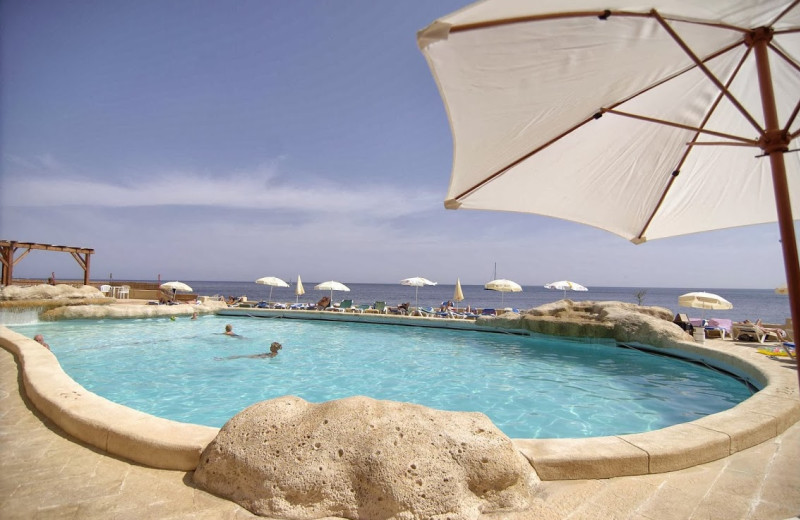 Outdoor pool at Preluna Hotels and Towers.