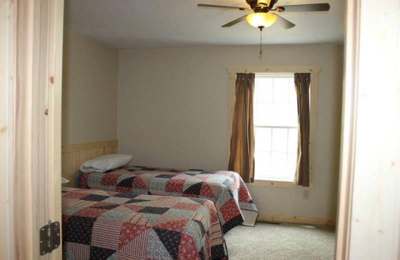 Cottage bedroom at Bonnie Beach Resort.