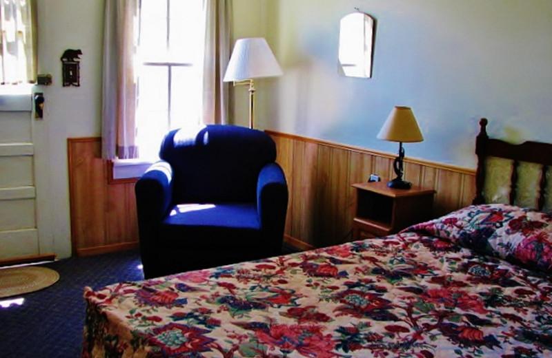 Guest bedroom at East Glacier Motel & Cabins.