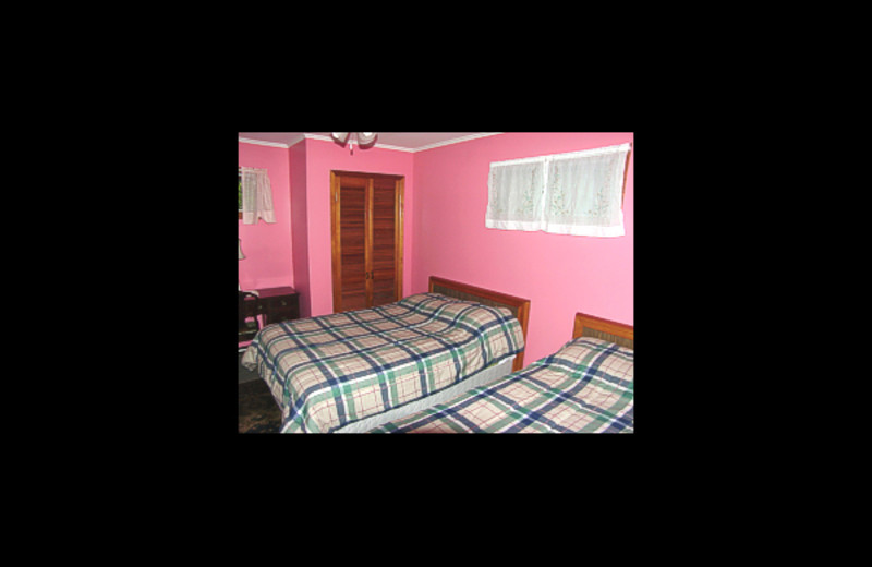 Cabin bedroom at Cool Ledge Family Resort.