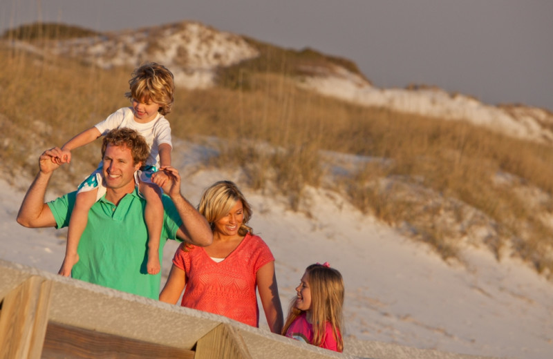 Family on the beach at Newman-Dailey Resort Properties, Inc.