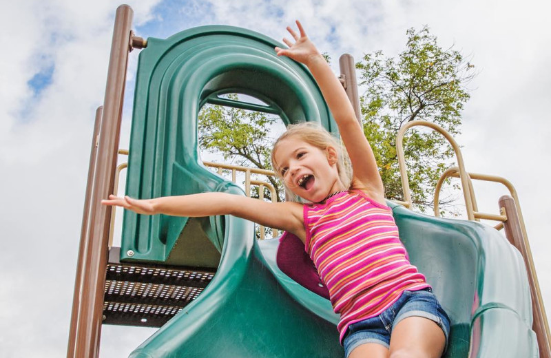 Kid on slide at Great Blue Resorts- McCreary's Beach Resort.