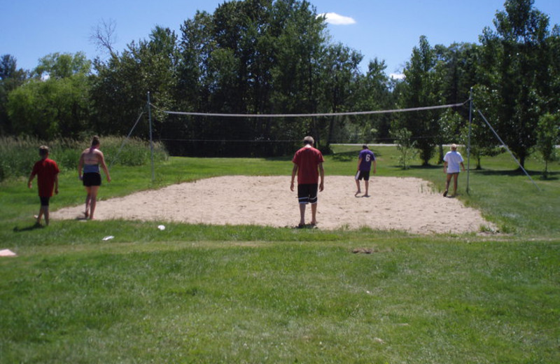 Playing volleyball at Cozy Bay Resort.
