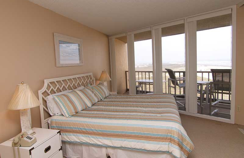 Condo bedroom at The Dunes Condominiums.
