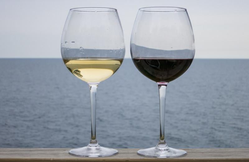 Wine glasses and lake view at Waters Edge B&B Resort.