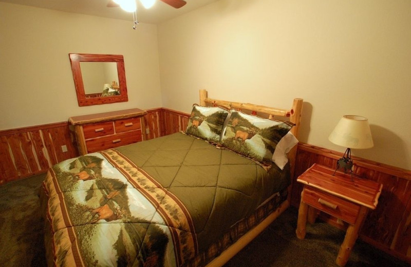 Cabin bed at Lake Forest Luxury Log Cabins.