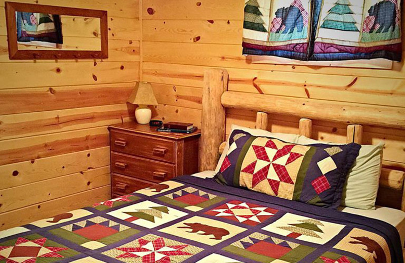 Cabin bed at Silver Mountain Resort and Cabins.