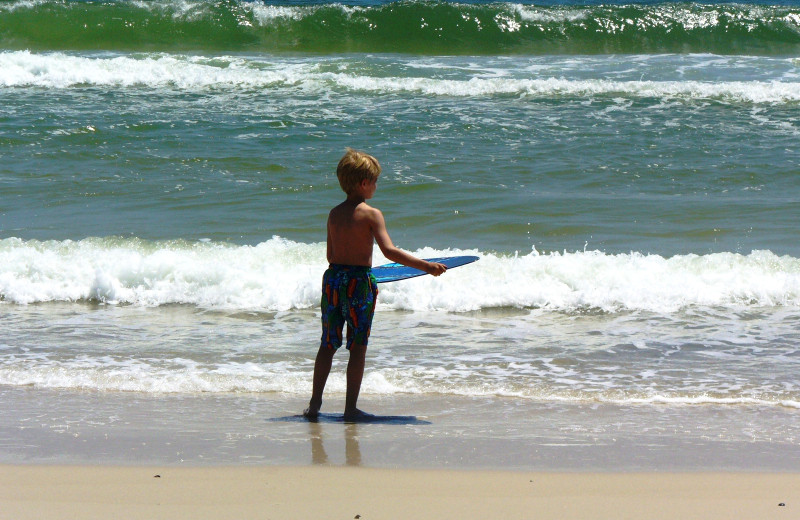 Kid on beach at Gulf Shores Vacation Rentals.