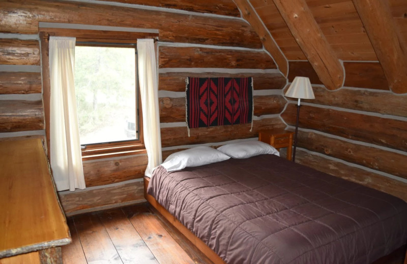 Cabin bedroom at Drummond Island Resort and Conference Center.